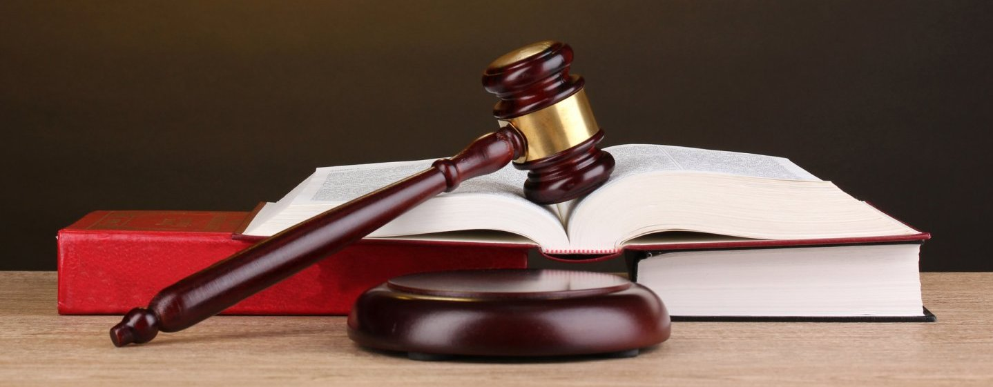 Workers comp law gavel and law book.