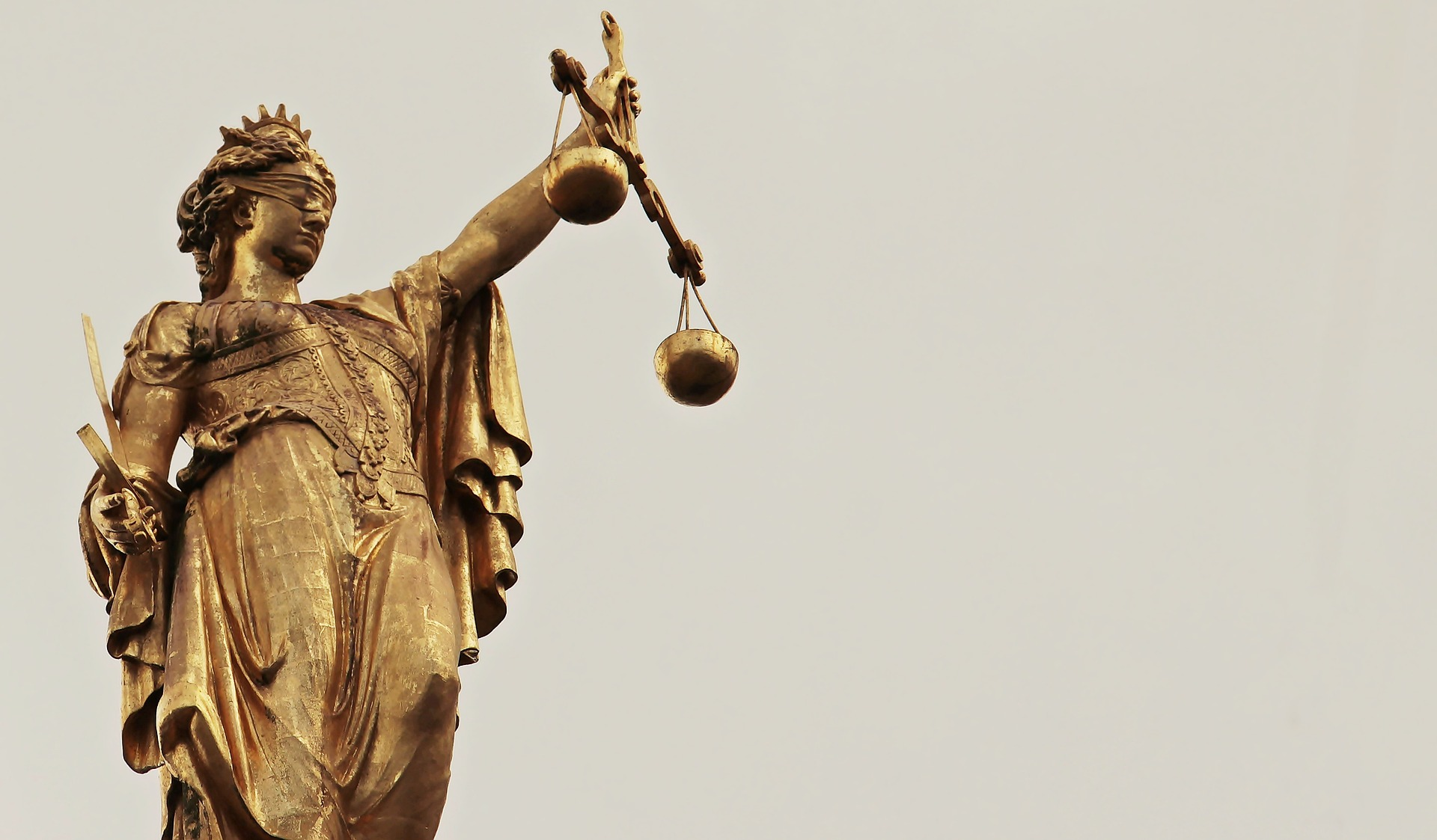 Lady justice holding a scale.