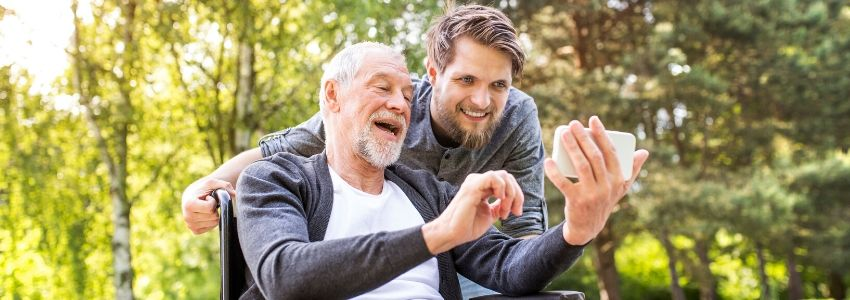 A father and son review their social security payments schedule.