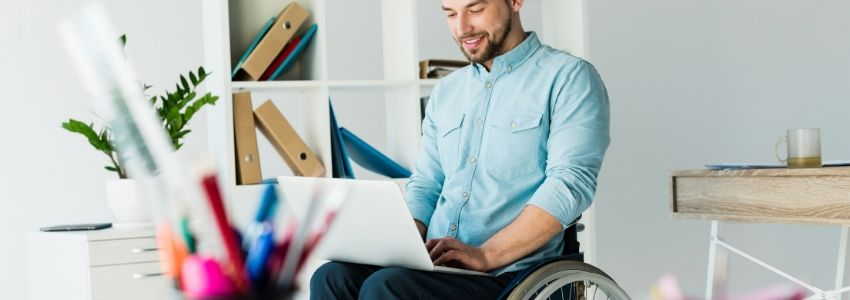 A disabled man researching disability lawyers.