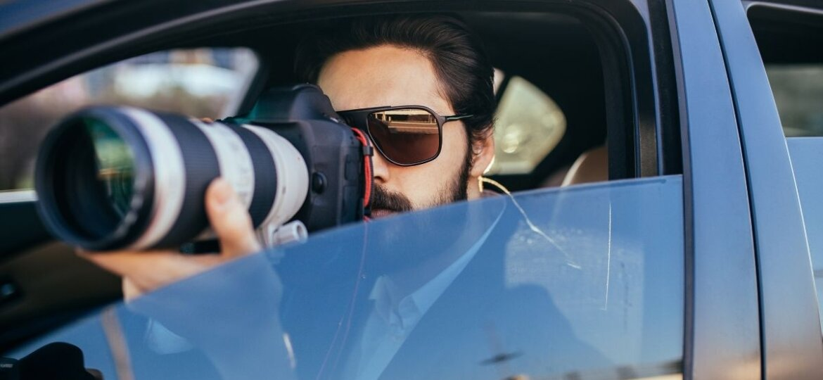 A workers compensation investigator spying from their car.