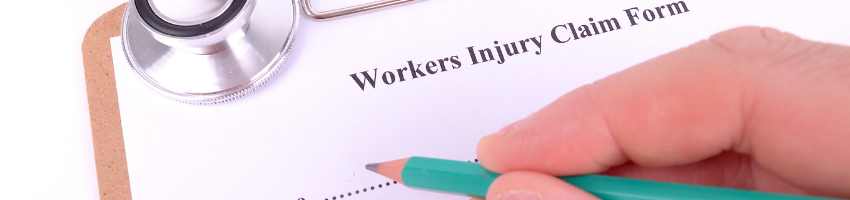 A person filling out a workers compensation claim form.