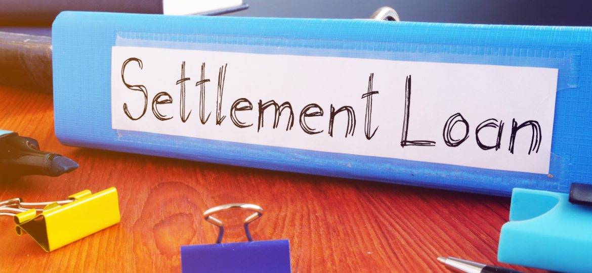 A paper on an office desk that says settlement loans.