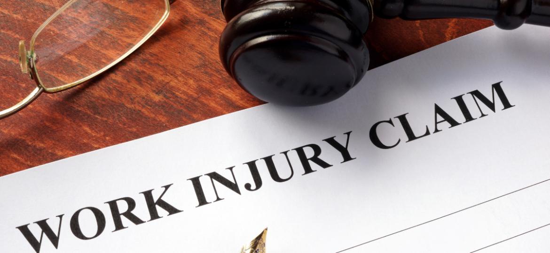 A work injury claim document on a lawyers desk.