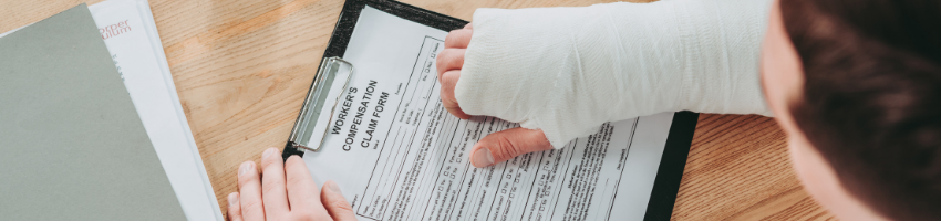 A man with a broken arm filling out a workers compensation application.